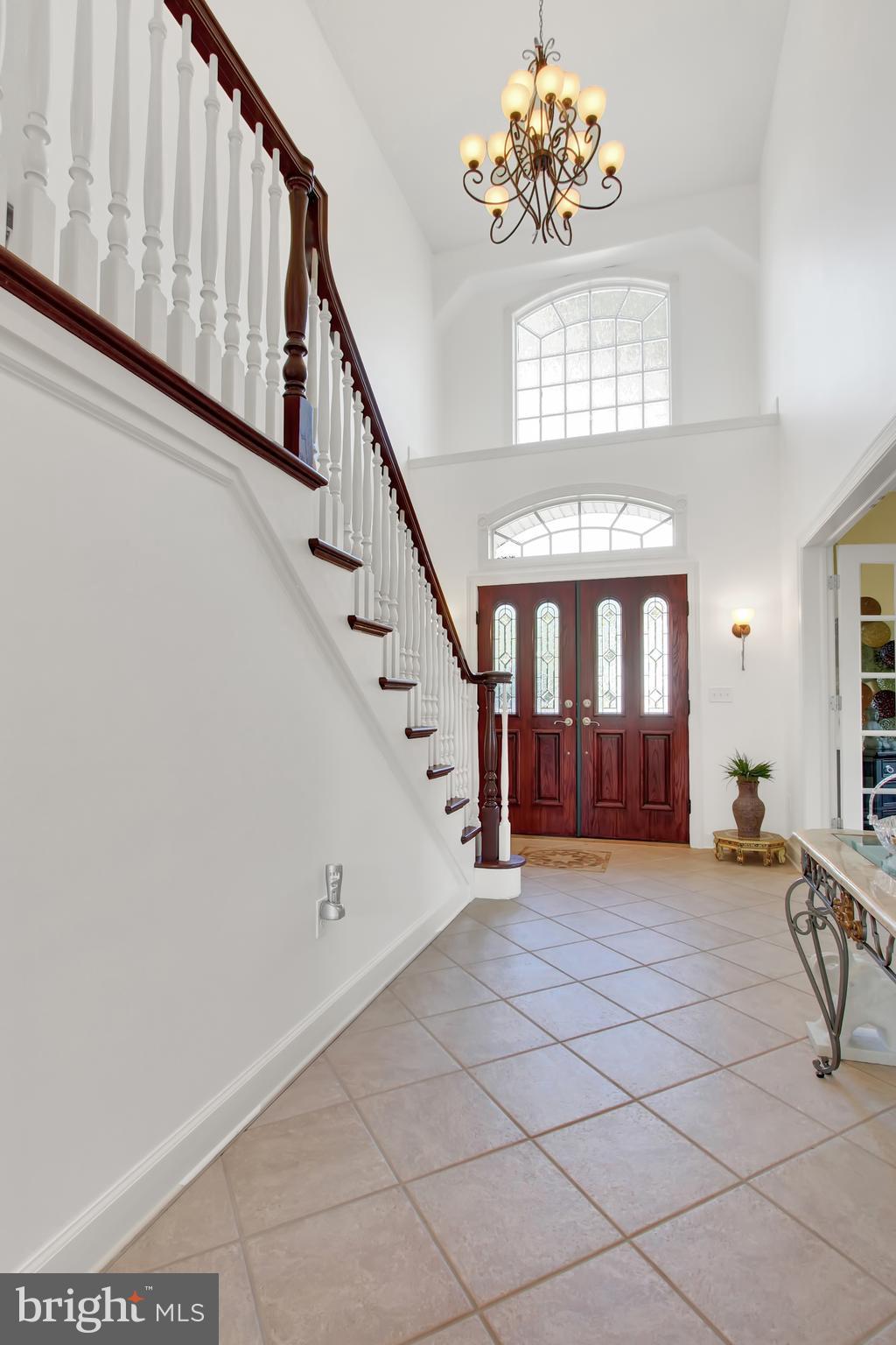 Elaborate chandelier, tiled flooring, open layout