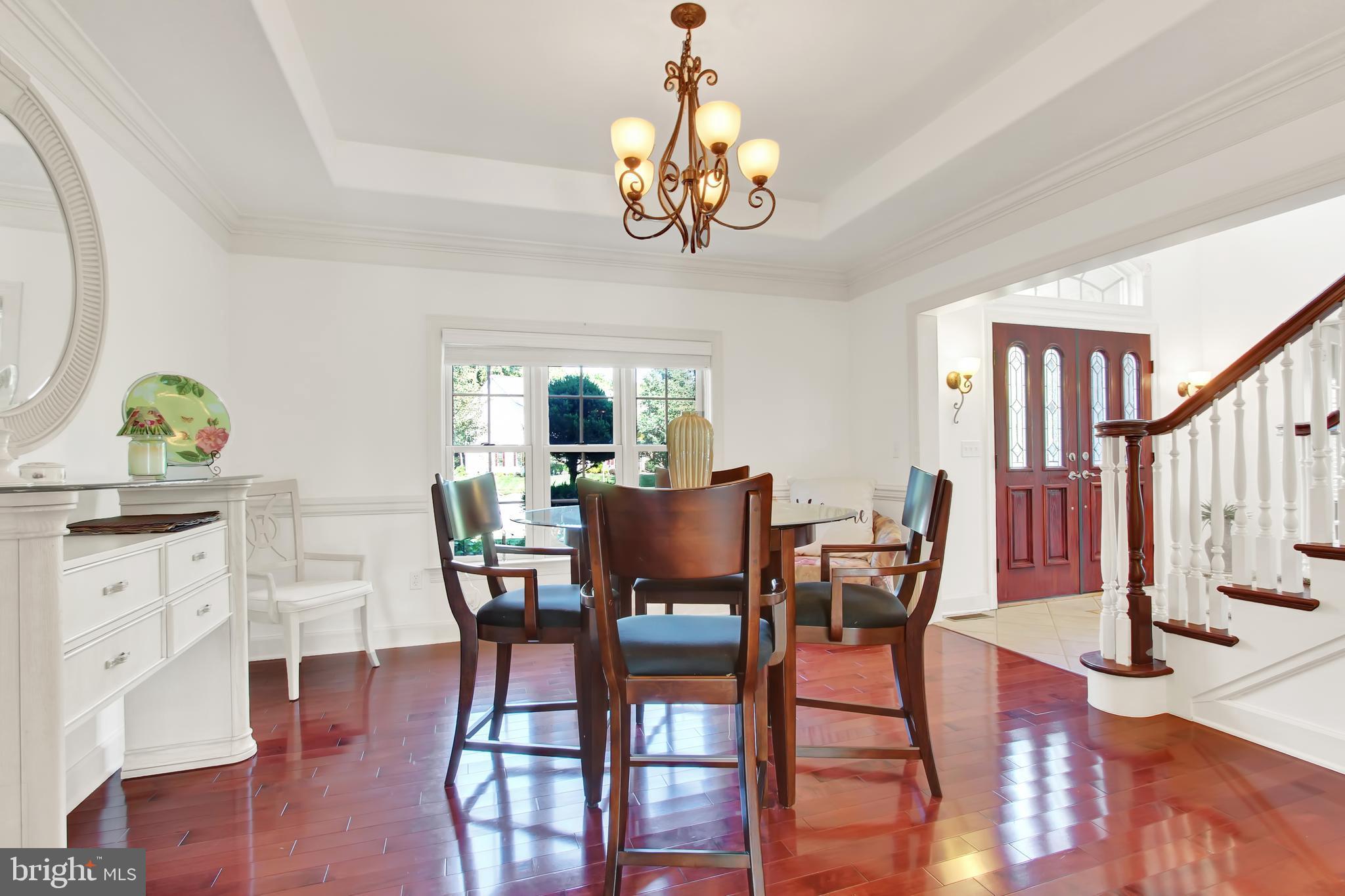 Formal dining room, natural light, hardwood floors