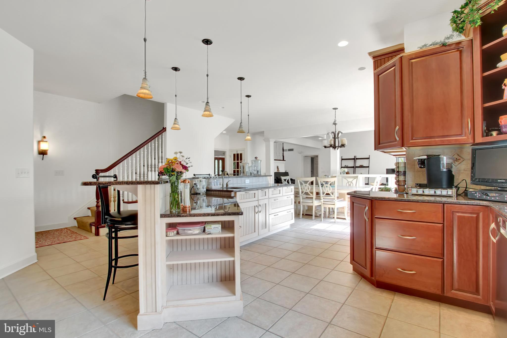 Clean, sleek white walls, cherry cabinets