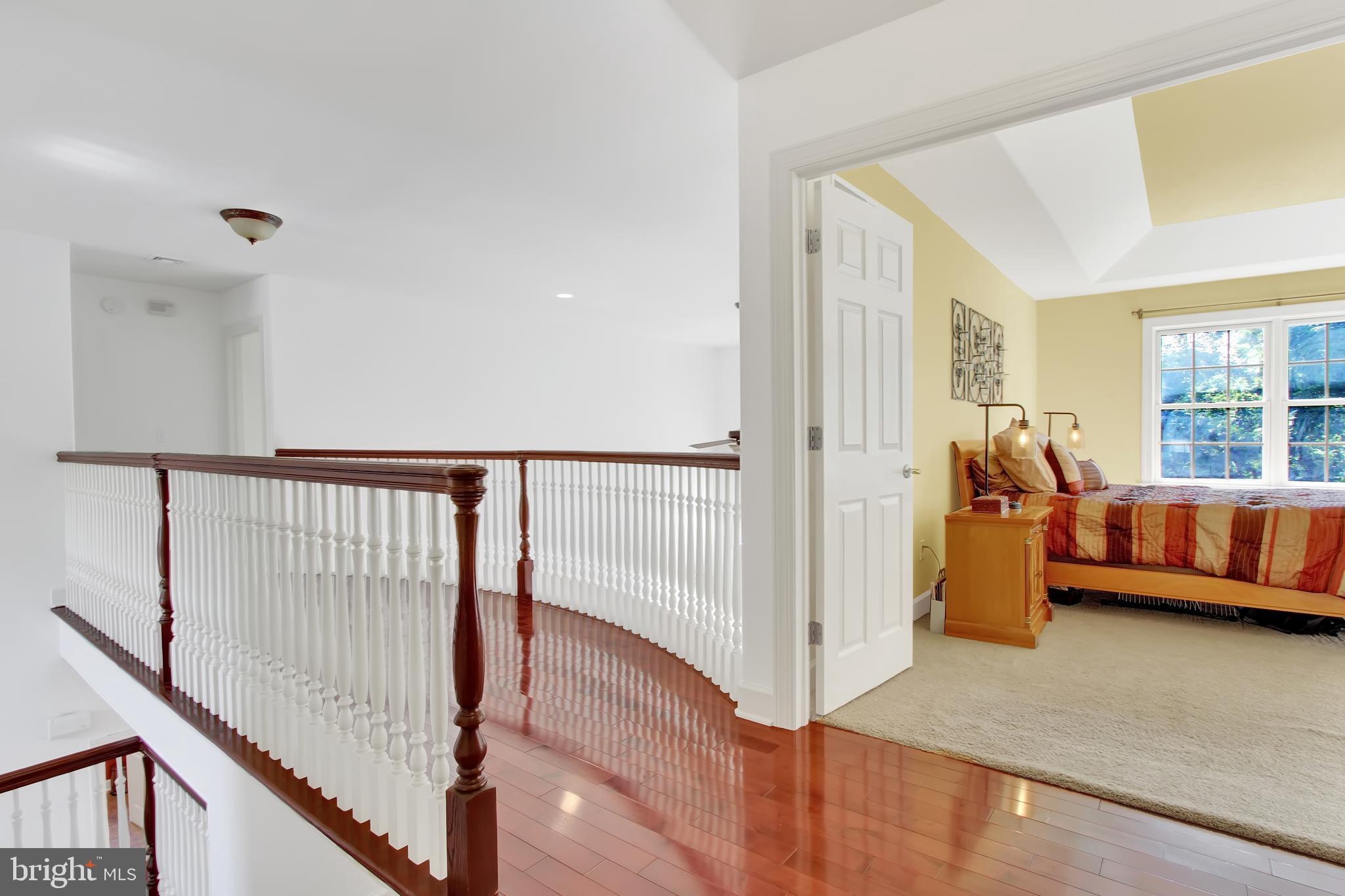 Hardwood loft hallway overlooks living room