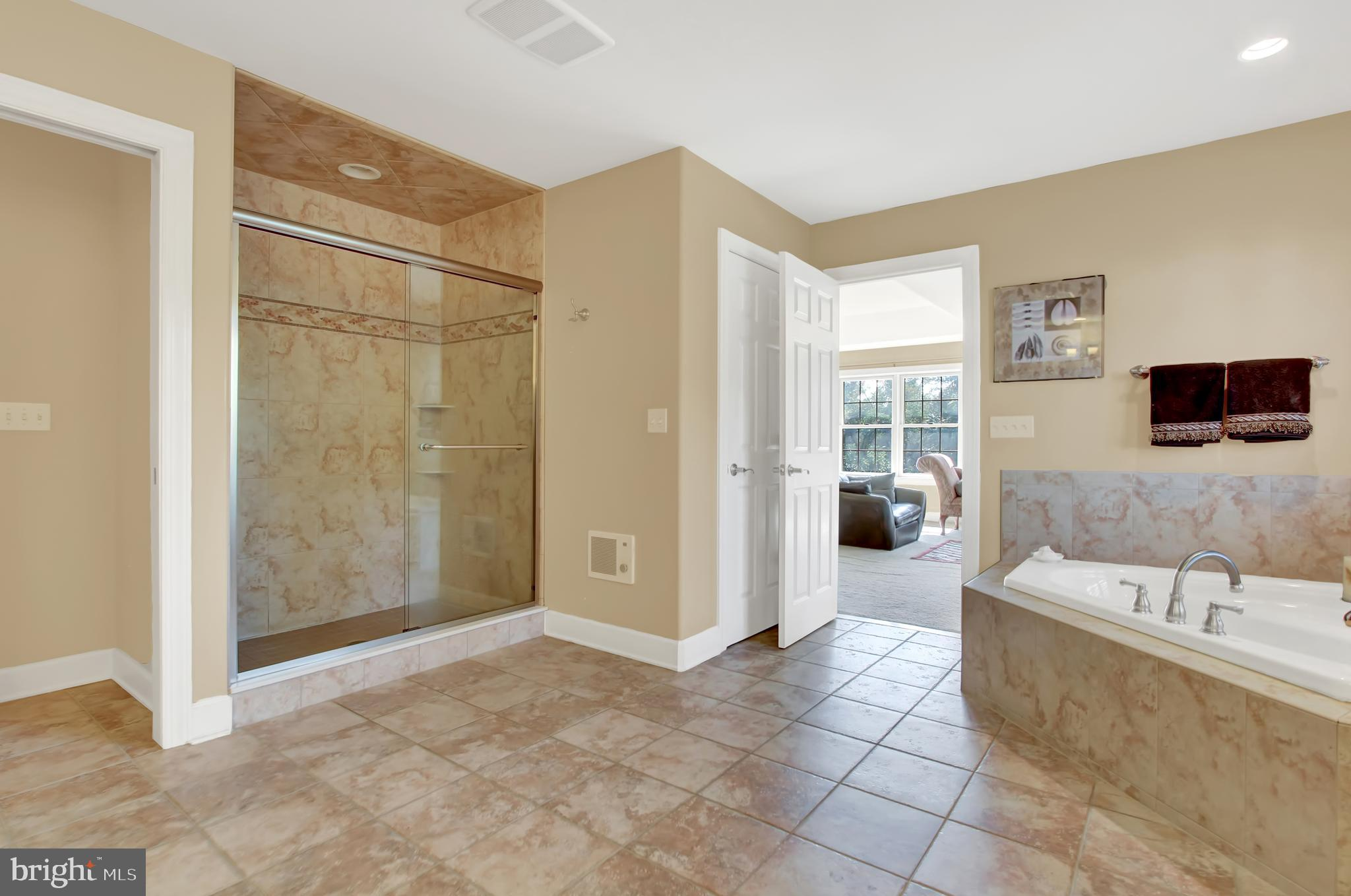 Tiled shower with jets, separate room for toilet