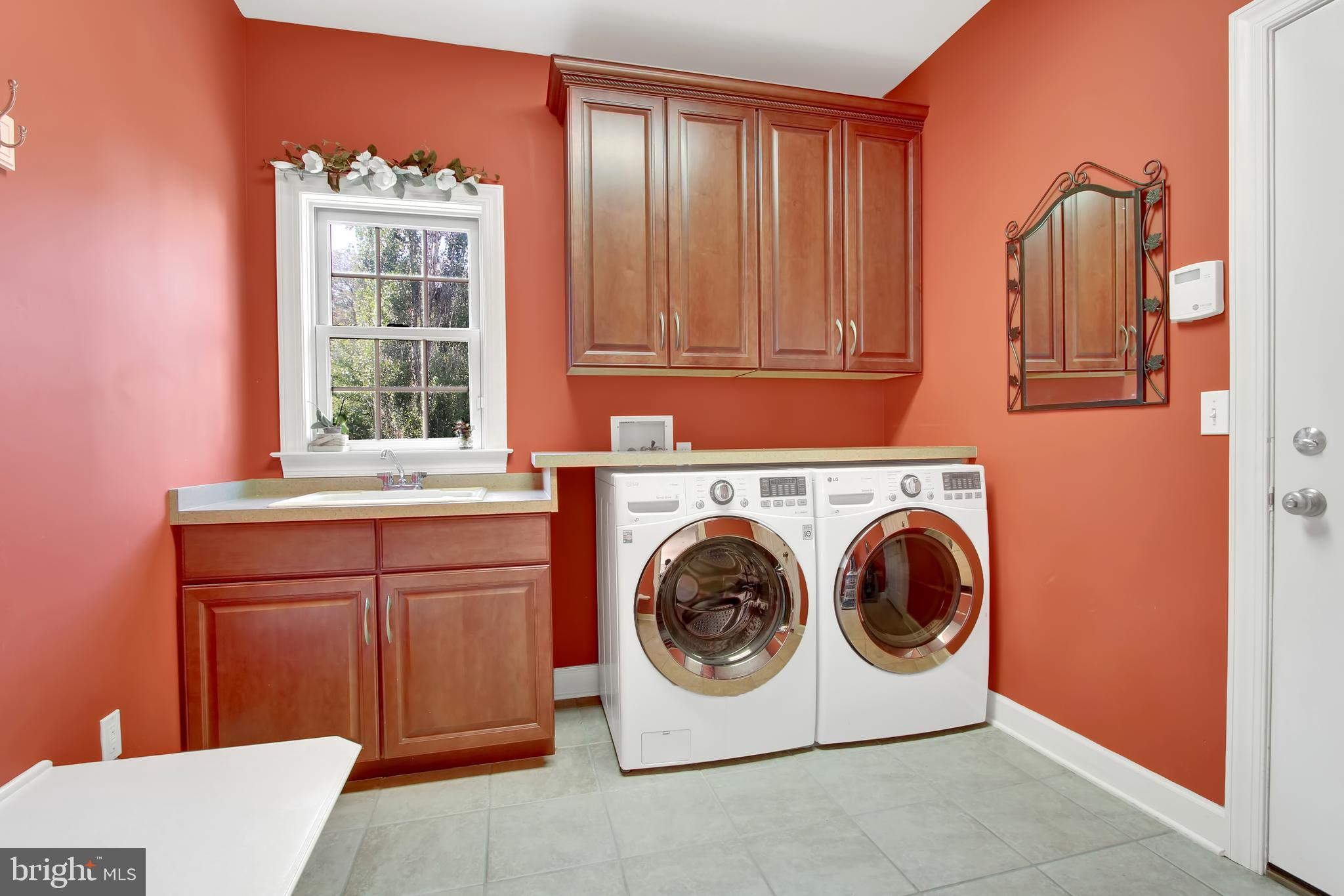 Laundry room/mudroom with access to 3-car garage