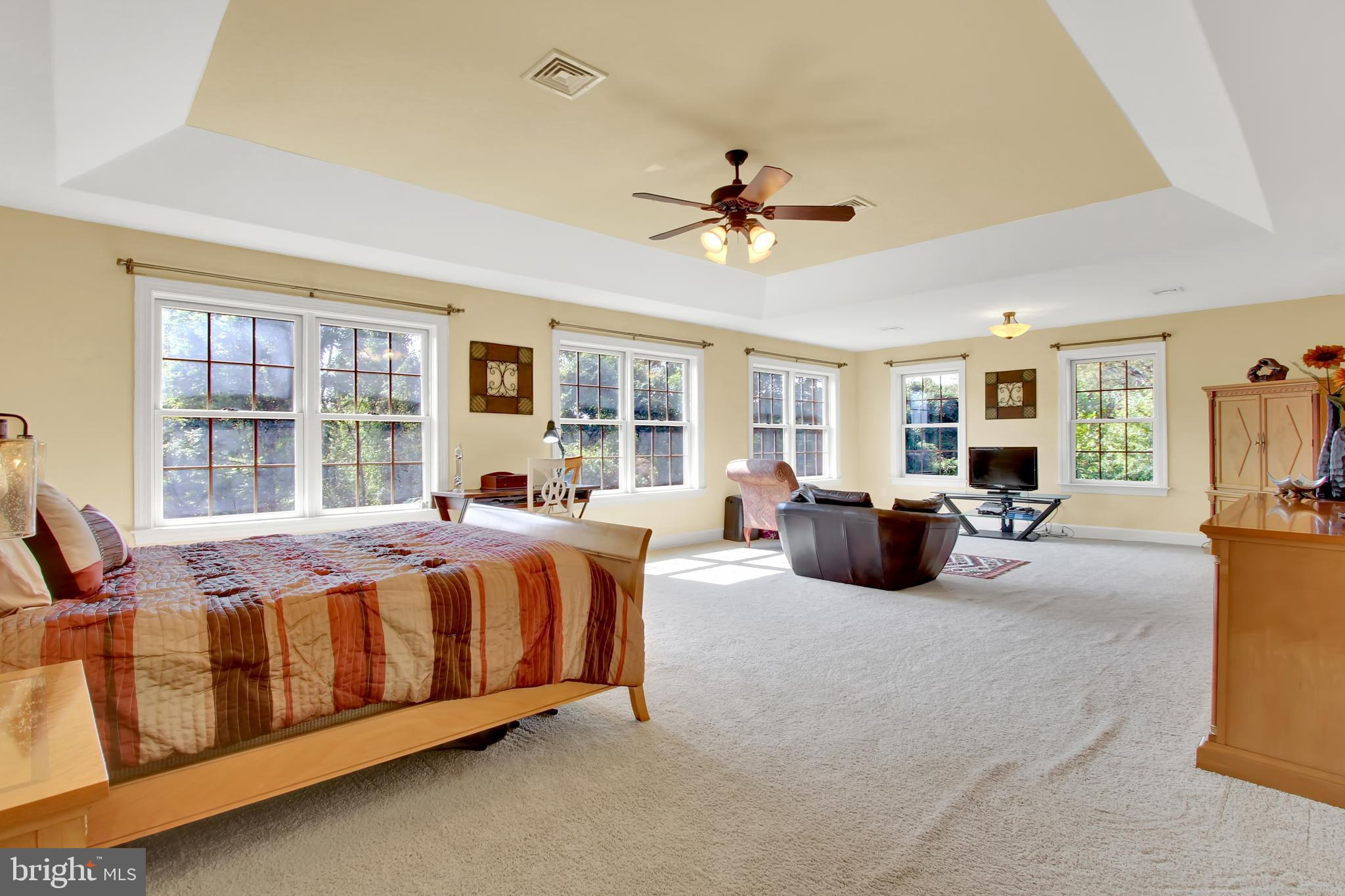 Spacious and open master suite with sitting area