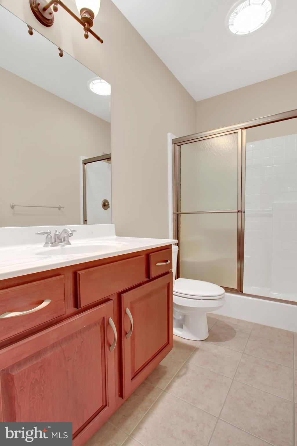 Full, modern bath with stall shower