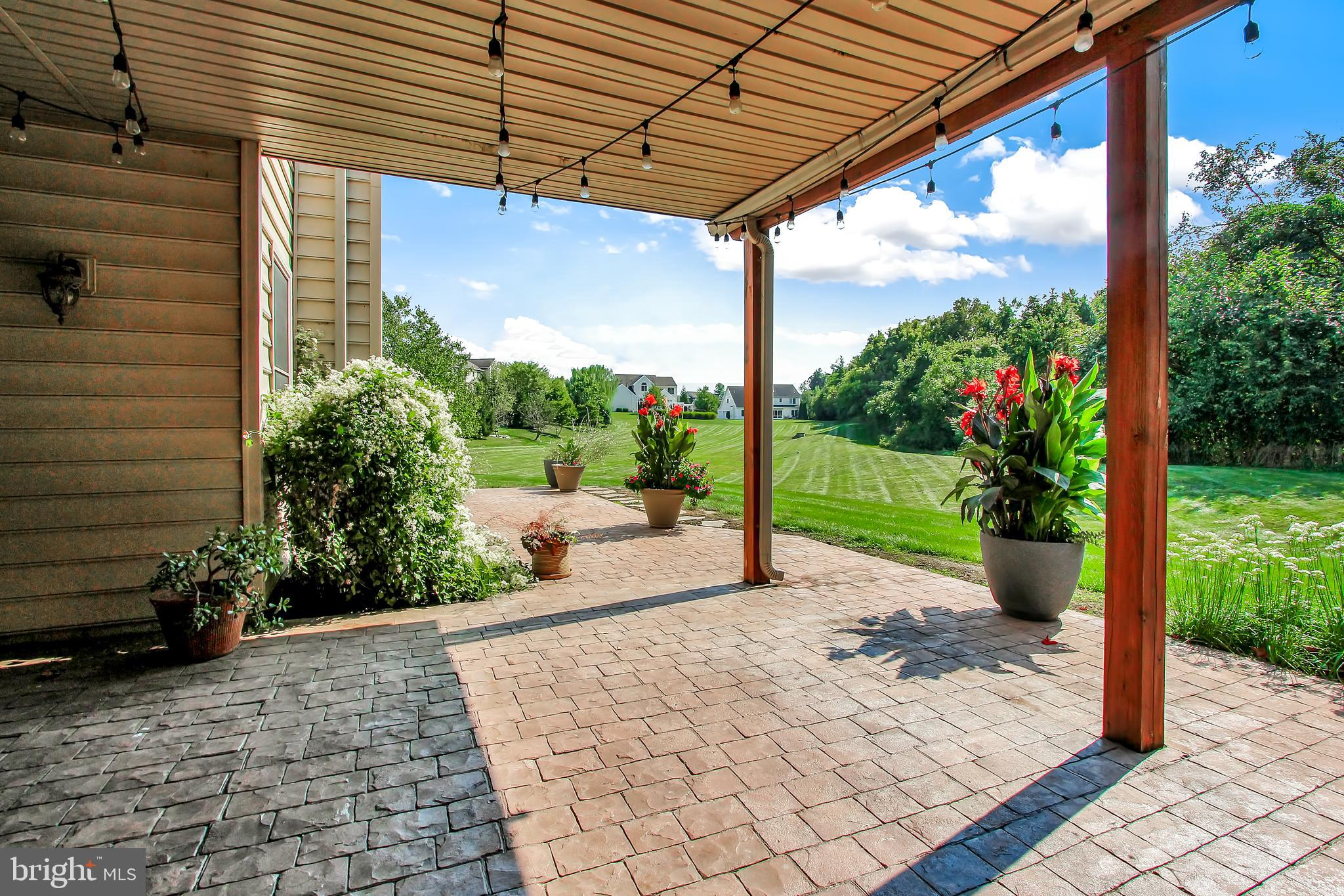 Covered stone patio directly off of basement