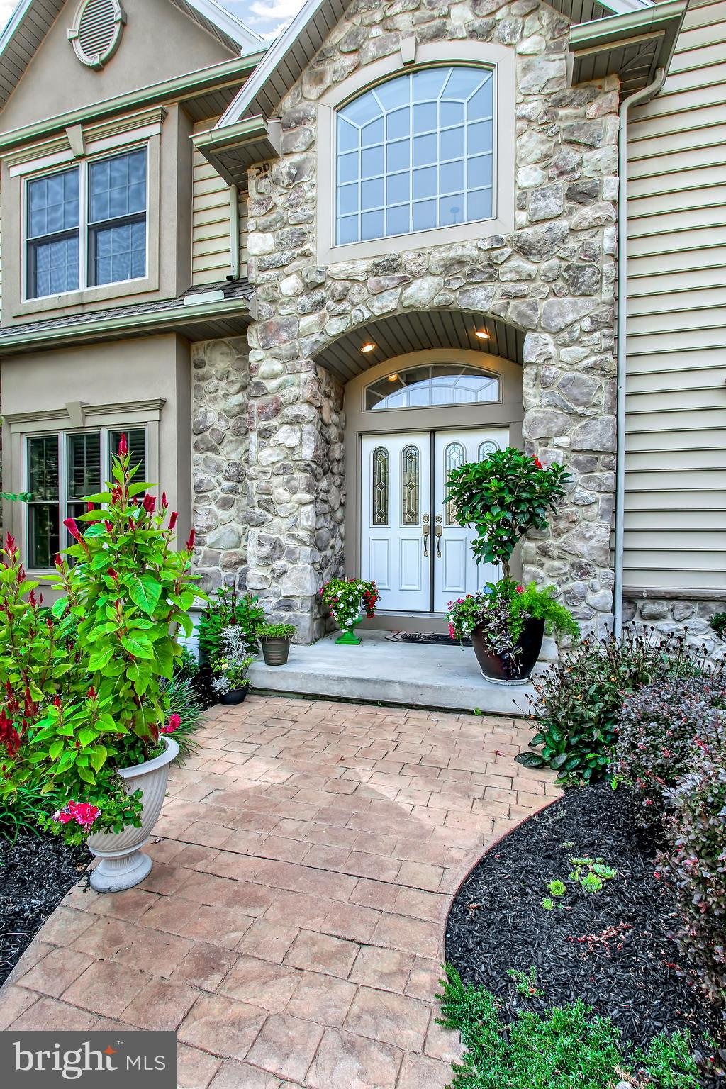 Double front doors add a touch of luxury to home