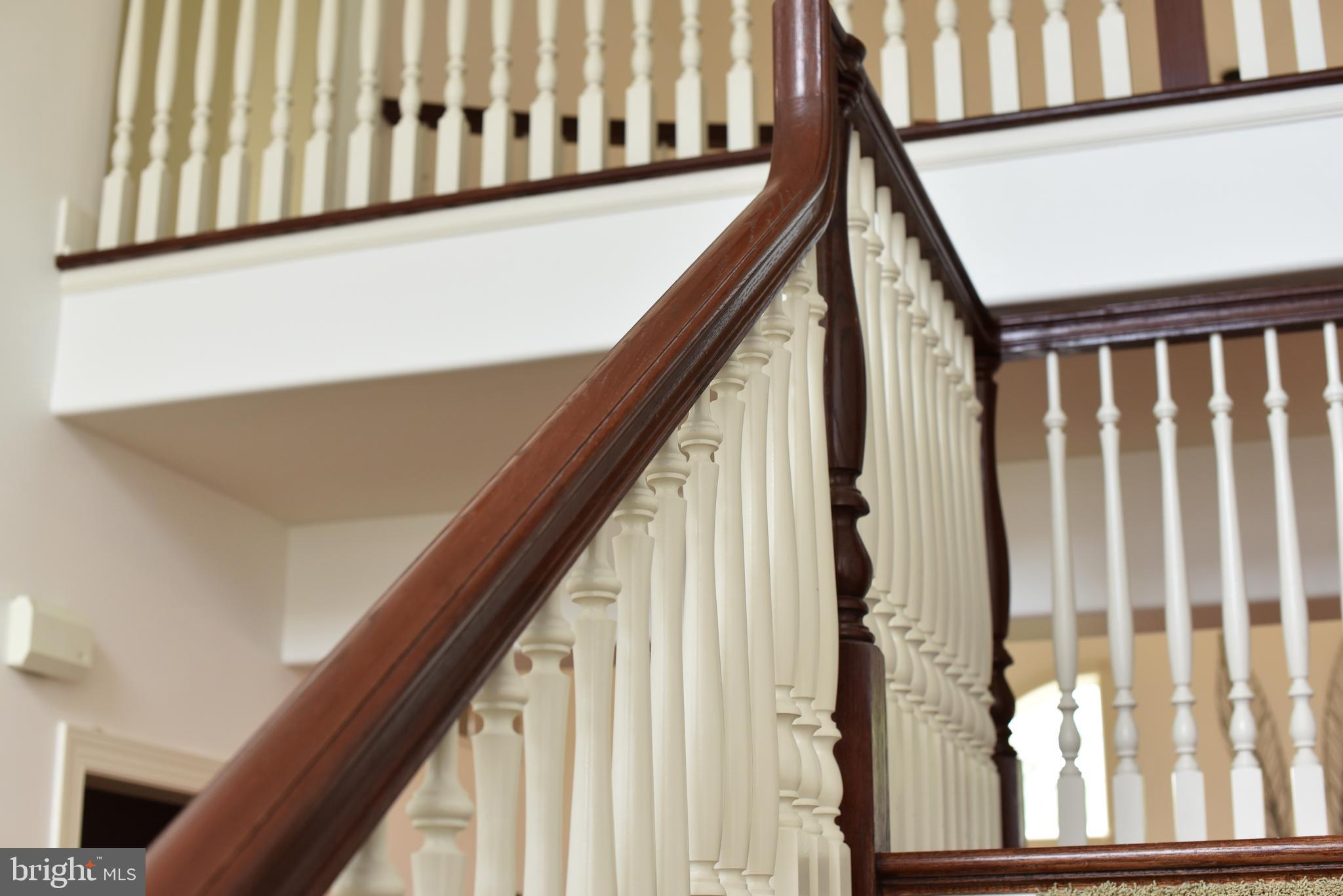 Grand staircase leads to second floor