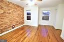 Master Bedroom w/Exposed Brick and Hardwood Floors - 131 R ST NE, WASHINGTON