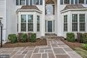 Beautiful flagstone walk way to covered front door - 42944 DEER CHASE PL, ASHBURN