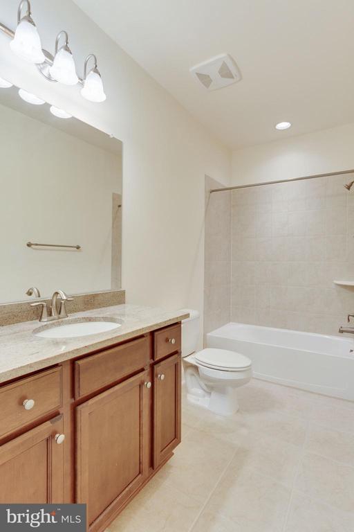 Full bathroom in lower level. - 1709 BESLEY RD, VIENNA