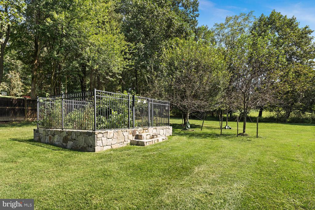 Raised garden with stone foundation and deer fence - 9110 DARA LN, GREAT FALLS