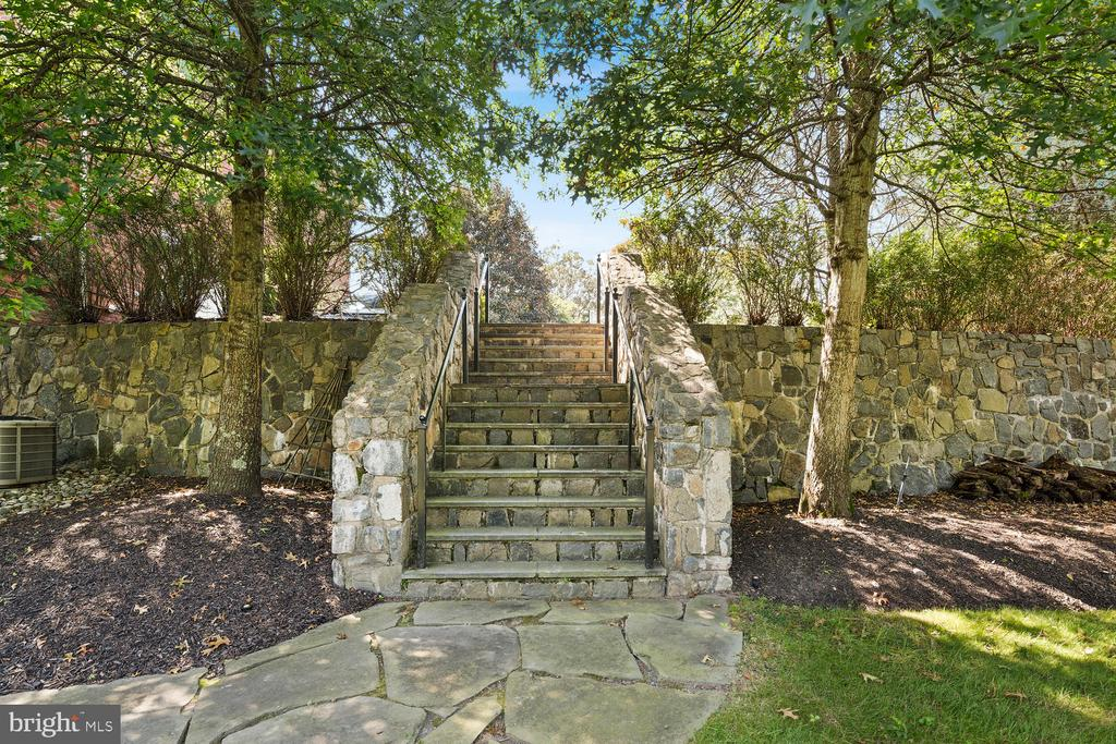 Stone staircase from upper yard to driveway - 9110 DARA LN, GREAT FALLS