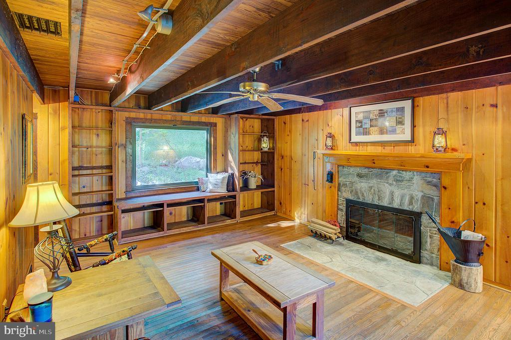Family room with stone fireplace - 16657 TREE CROPS LN, ROUND HILL