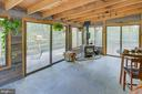 Enclosed porch has slate flooring and wood stove - 16657 TREE CROPS LN, ROUND HILL