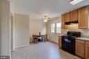 Large kitchen w/ granite countertops - 15085 GALAPAGOS PL, WOODBRIDGE