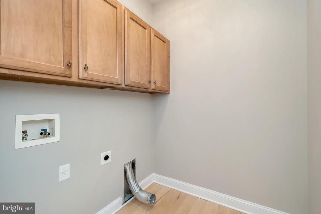laundry room /plenty of cabinets! - 308 WILDERNESS DR, LOCUST GROVE