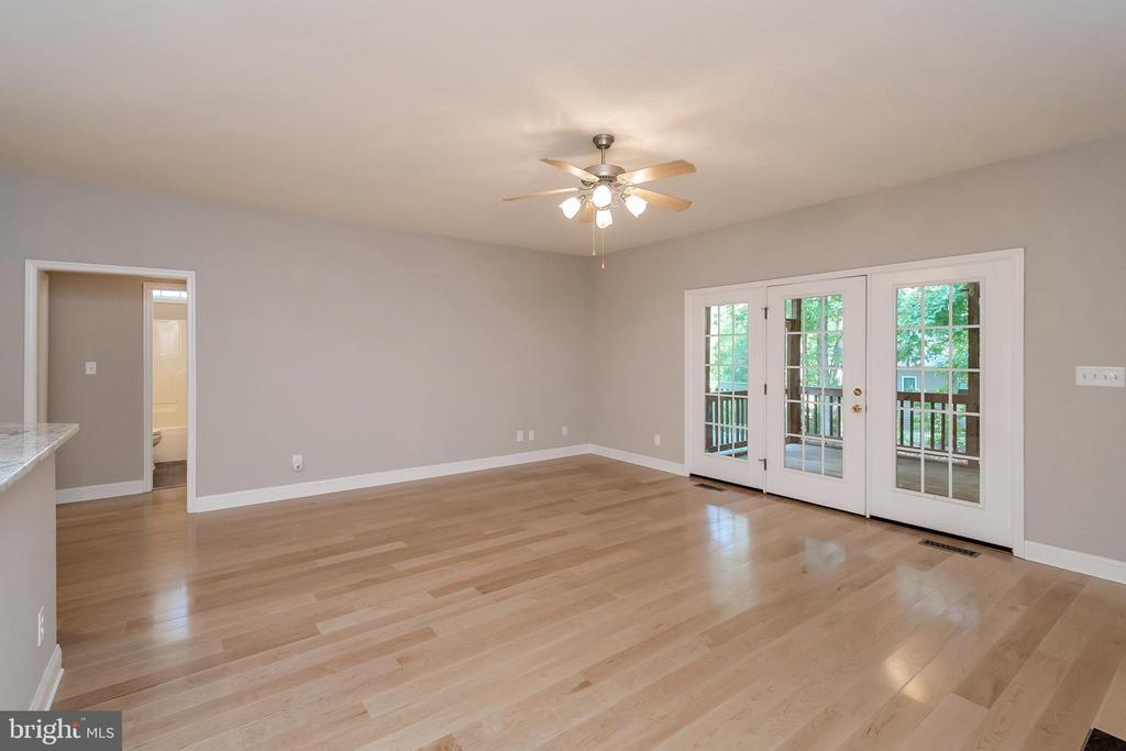 Family room with Maple hardwood floors - 308 WILDERNESS DR, LOCUST GROVE