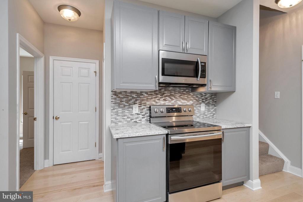 Kitchen boasts new stainless appliances - 308 WILDERNESS DR, LOCUST GROVE