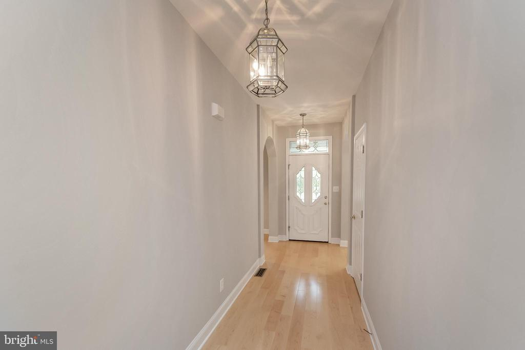 Gleaming wood floors greet you at the door - 308 WILDERNESS DR, LOCUST GROVE
