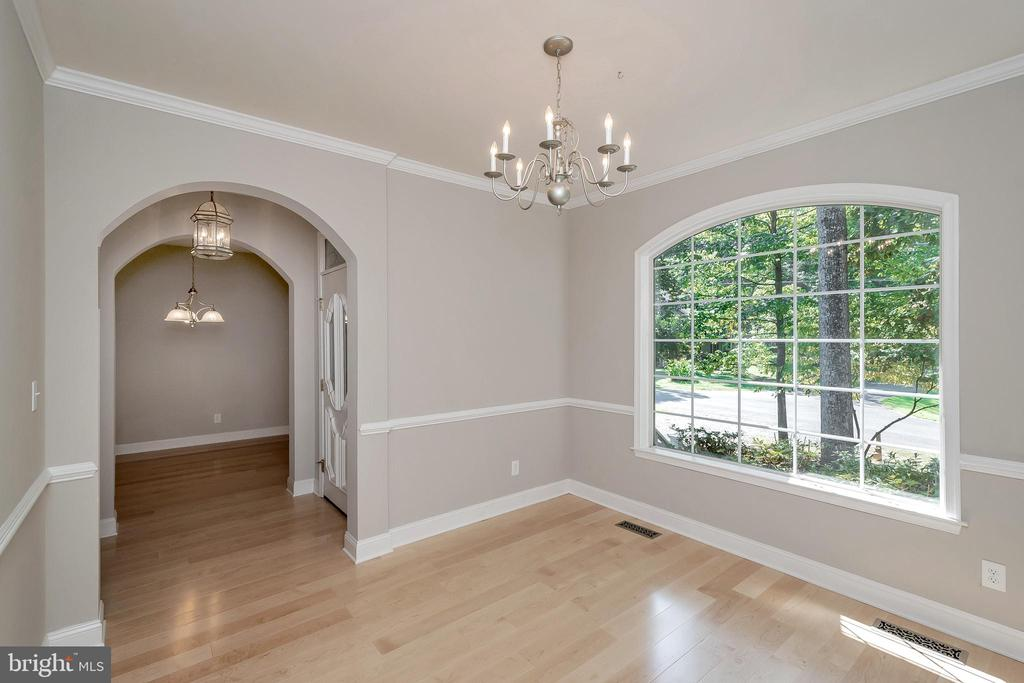 Dining room opens to foyer and kitchen - 308 WILDERNESS DR, LOCUST GROVE