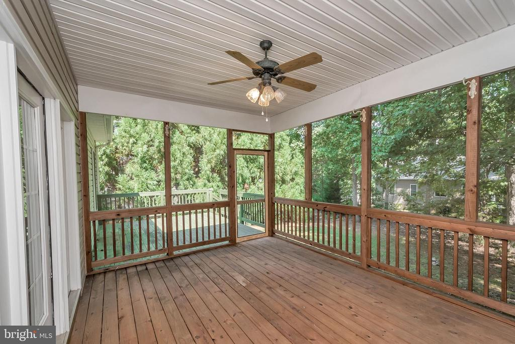 Screened in porch with ceiling fan - 308 WILDERNESS DR, LOCUST GROVE