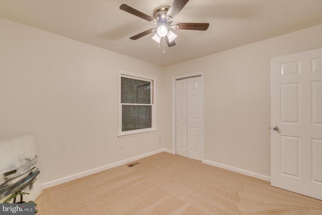 A new ceiling fan, fresh paint and new carpets - 145 HARRISON CIR, LOCUST GROVE