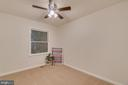 Bedroom 1 has a ceiling fan and large closet - 145 HARRISON CIR, LOCUST GROVE