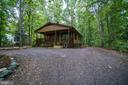 Enchanting trees and landscaping greet you - 145 HARRISON CIR, LOCUST GROVE