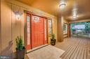 New lighting adds warmth to the large front porch - 145 HARRISON CIR, LOCUST GROVE
