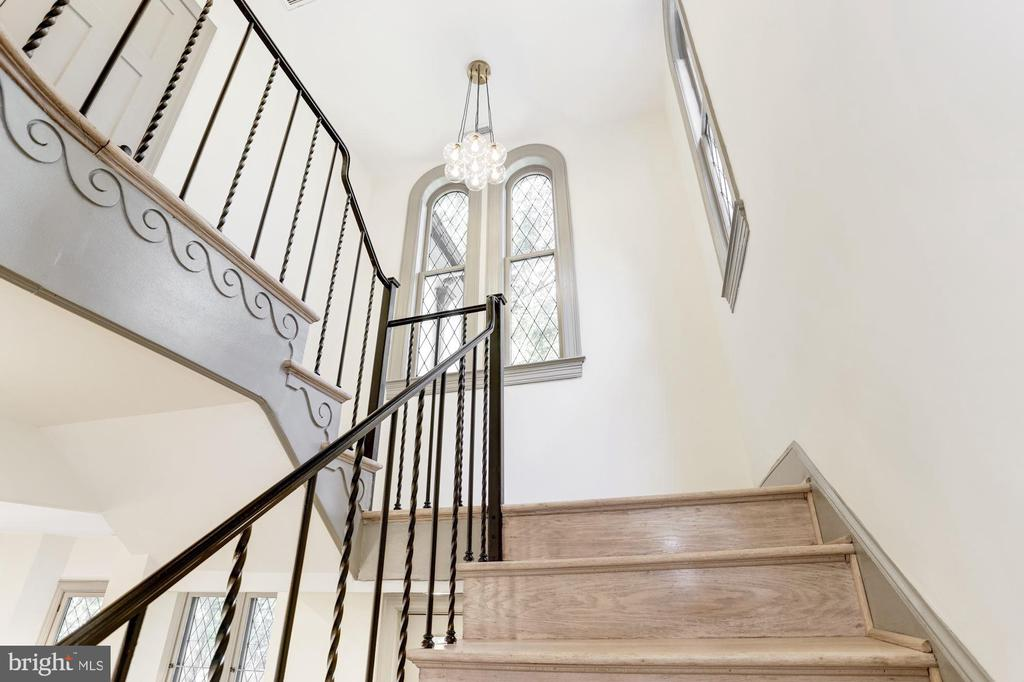 Grand staircase w/ restored leaded glass windows - 3601 VAN NESS ST NW, WASHINGTON