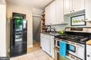 Light filled galley kitchen makes cooking a breeze - 2142 S OXFORD ST, ARLINGTON