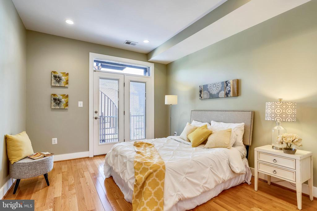 The first level bedrooms open to a balcony. - 1400 K ST SE #2, WASHINGTON