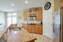 KITCHEN W/ GRANITE COUNTERS - 5401 ADAMSTOWN COMMONS DR, ADAMSTOWN