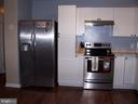 KITCHEN WITH STAINLESS STEEL APPLIANCES - 11504 GORDON RD, FREDERICKSBURG