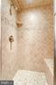 Gorgeous, custom tiling in all bathroom showers - 7395 BEECHWOOD DR, SPRINGFIELD