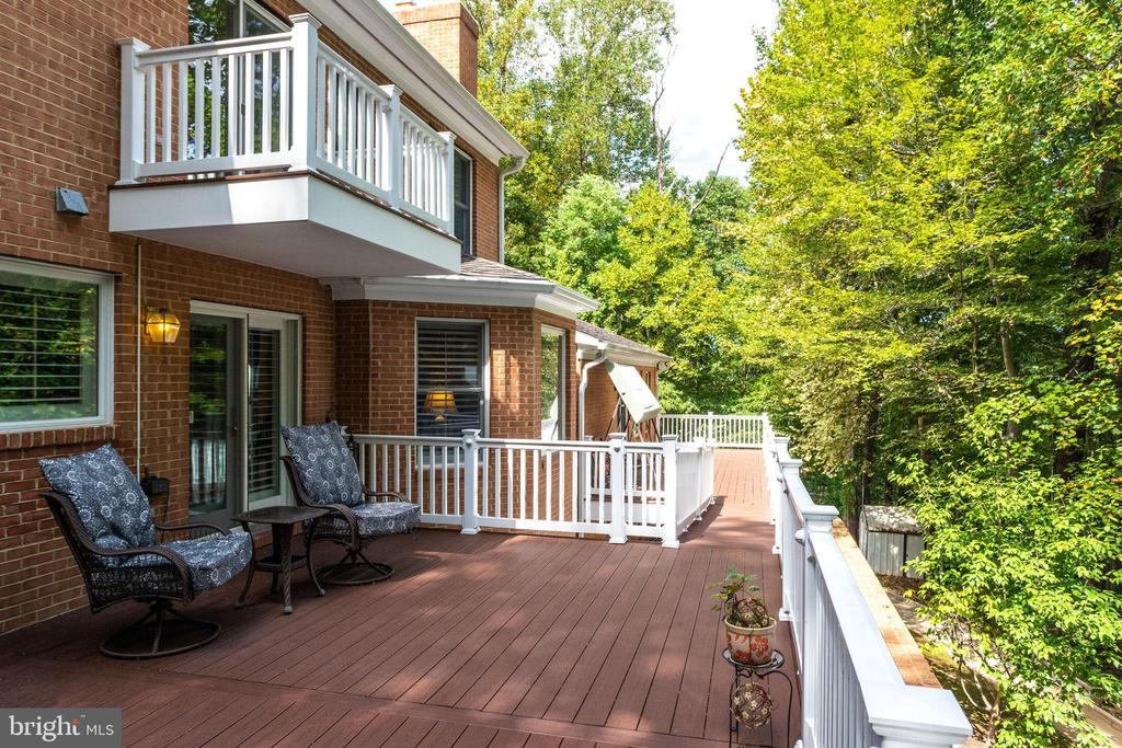 Expansive deck faces private, wooded rear yard - 7395 BEECHWOOD DR, SPRINGFIELD