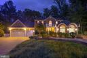 Day or night, this unique home is inviting - 7395 BEECHWOOD DR, SPRINGFIELD