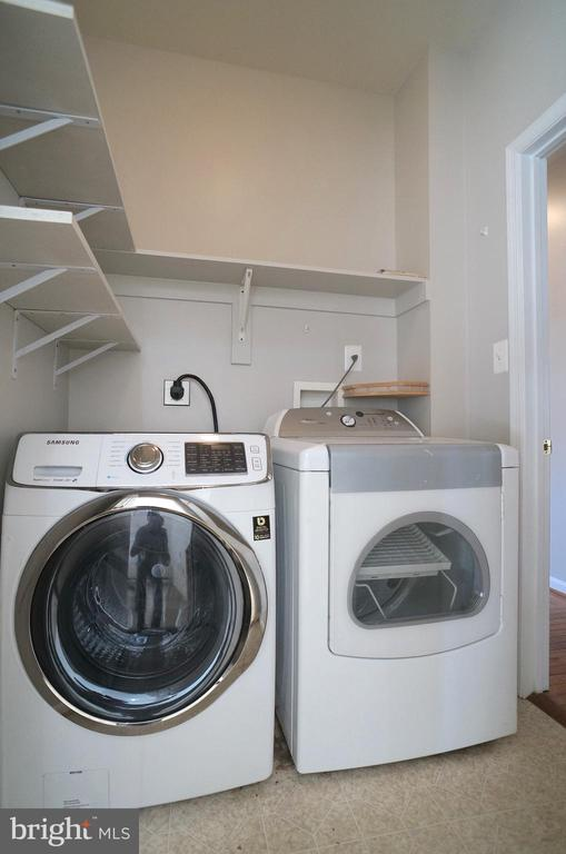 Laundry Room (7'x6') has Shelving & Door to Garage - 2004 WAVE DR, STAFFORD