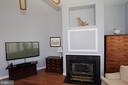 Wall decor above fireplace is actually a cabinet! - 806 SANTMYER DR SE, LEESBURG