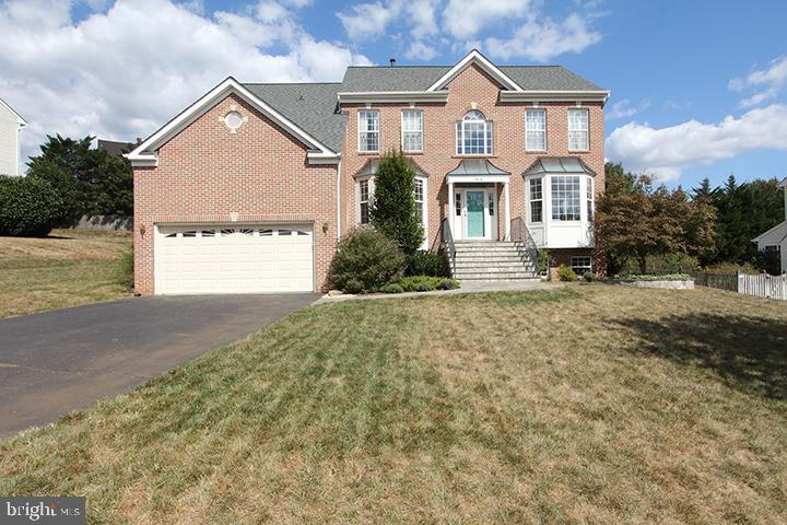Front of home with newer roof (2018) - 806 SANTMYER DR SE, LEESBURG
