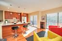 Kitchen/family seating area overlooking lake - 2031 LAKEWINDS DR, RESTON