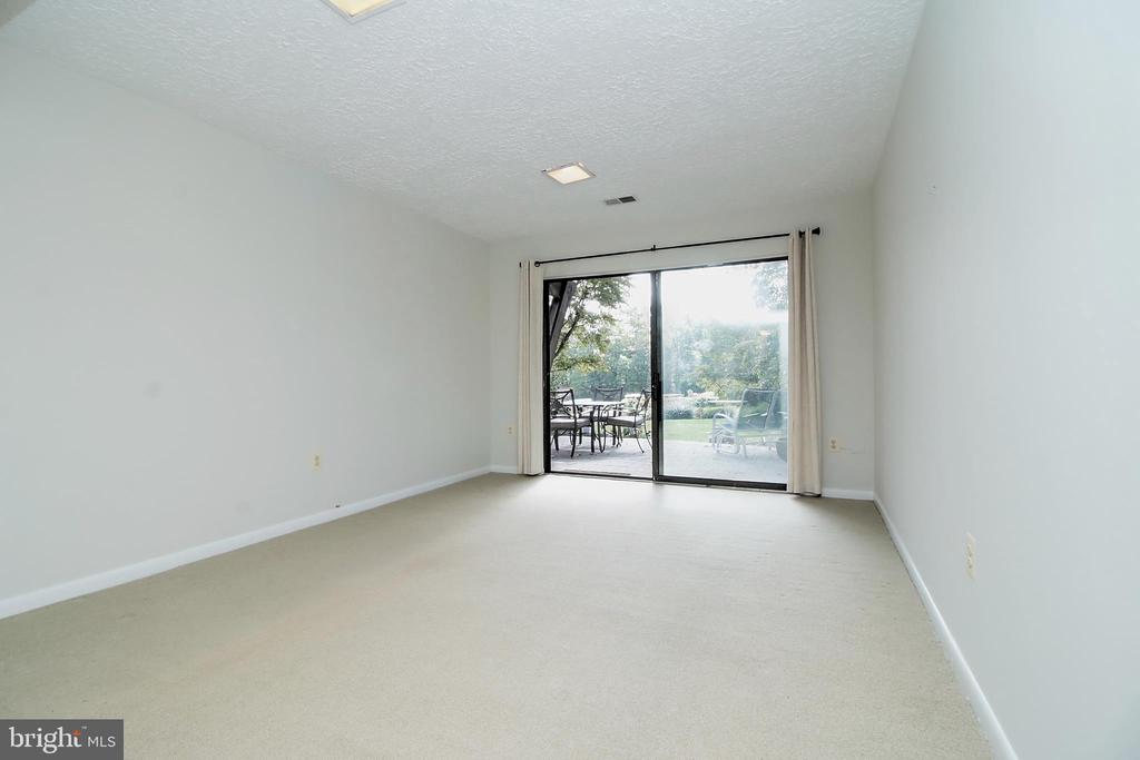 Recreation Room opens to patio overlooking lake - 2031 LAKEWINDS DR, RESTON