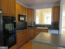 KITCHEN WITH PASS THROUGH TO DINGIN ROOM - 336 CAMERON STATION BLVD, ALEXANDRIA