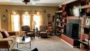family room with wood burning fireplace - 9355 DEVILBISS BRIDGE RD, WALKERSVILLE