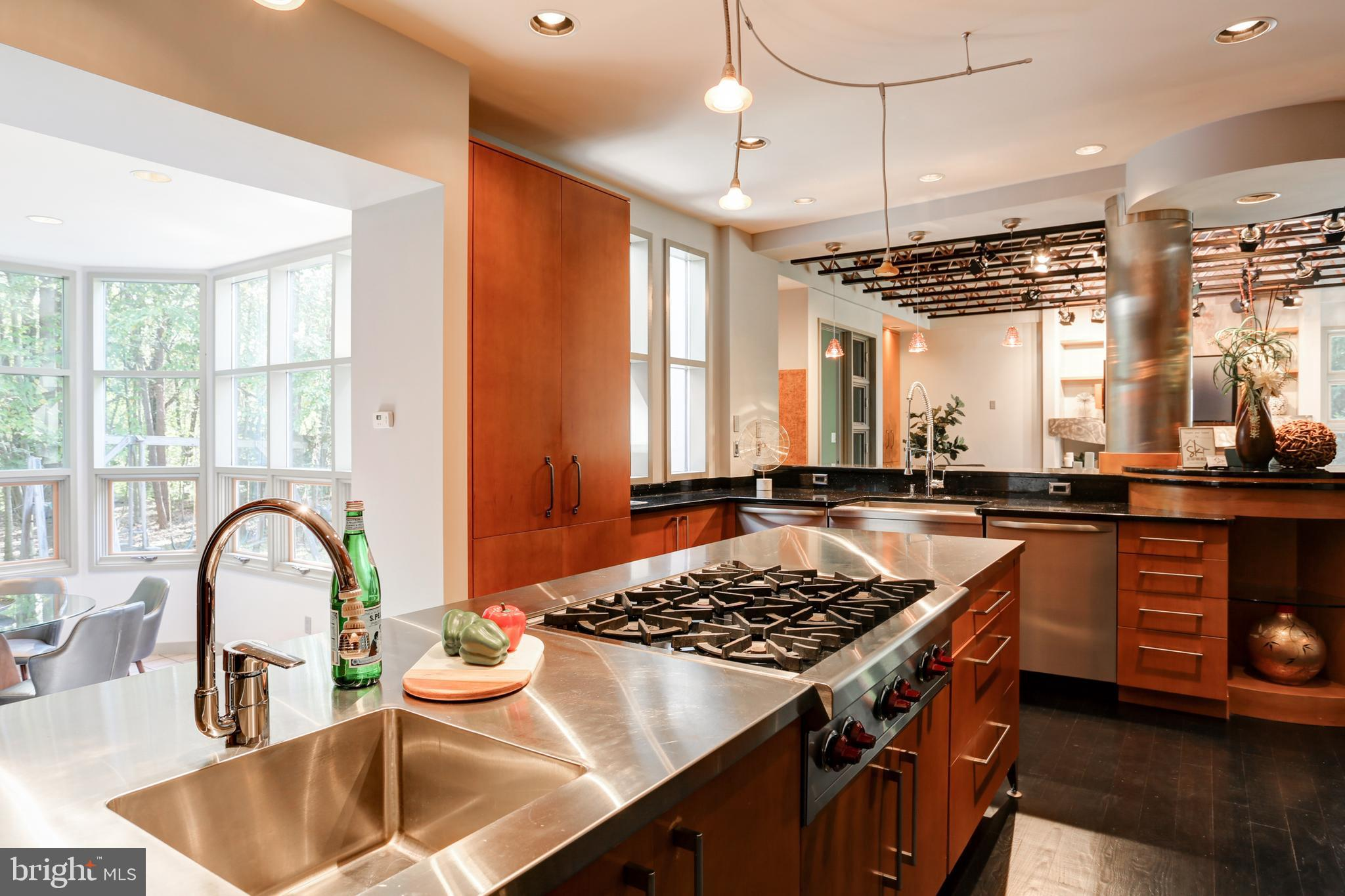 The gourmet kitchen boasts stainless prep area...