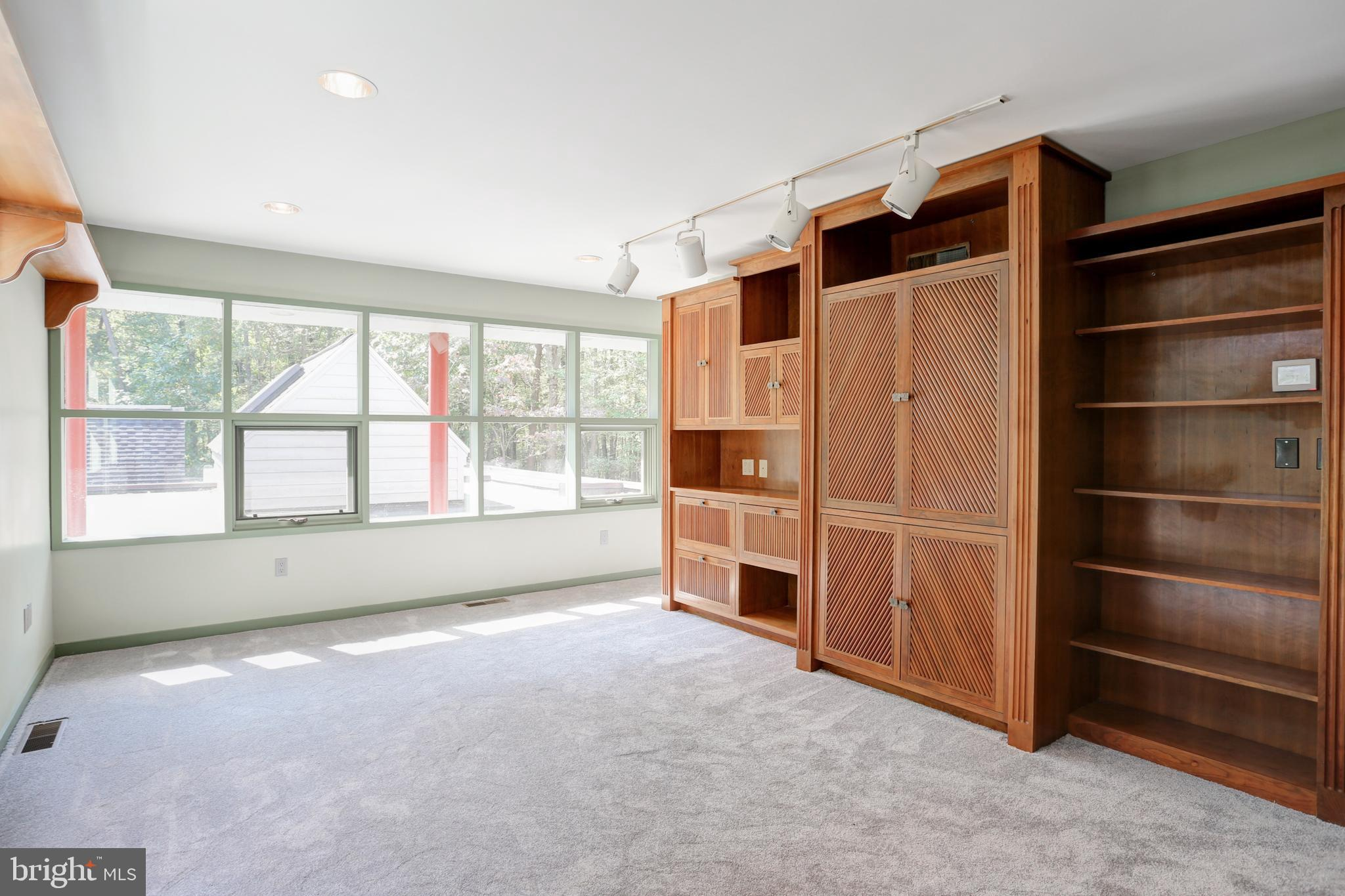 With balcony and custom built-ins, which could...