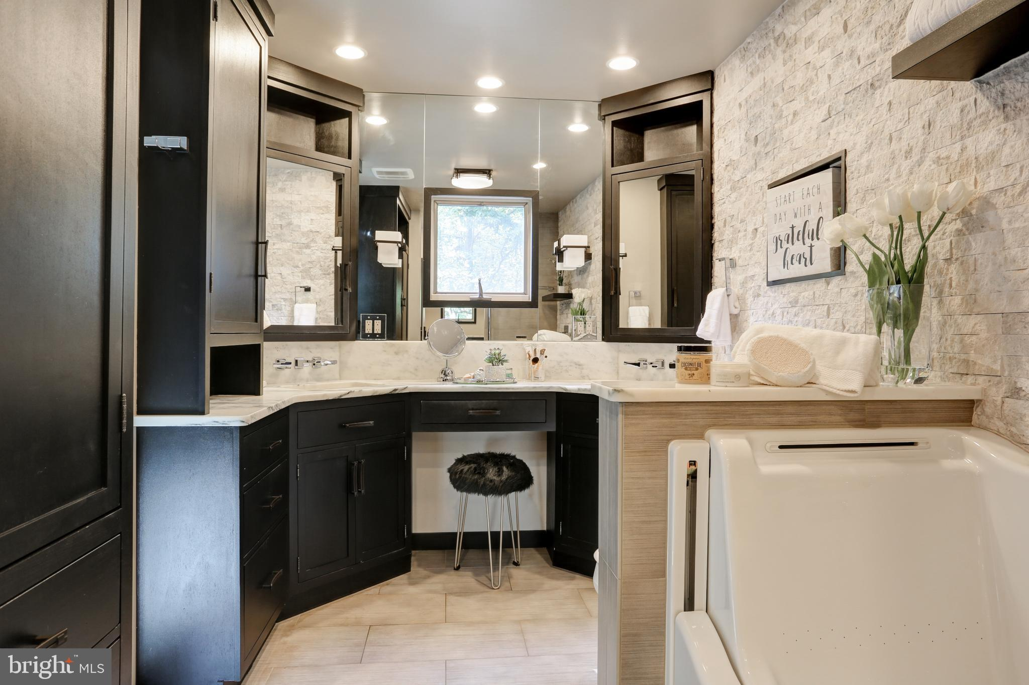 Master bath with seat-height tub and dual sinks