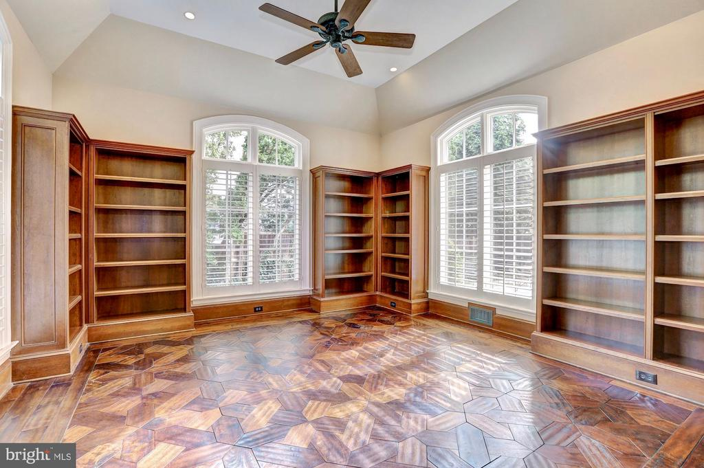 Library with custom wood flooring and built-ins. - 116 E MELROSE ST, CHEVY CHASE