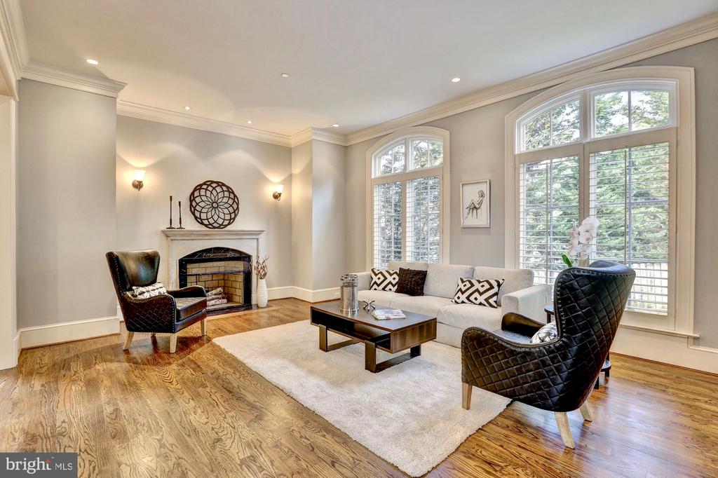 Living room with oversized windows and fireplace. - 116 E MELROSE ST, CHEVY CHASE