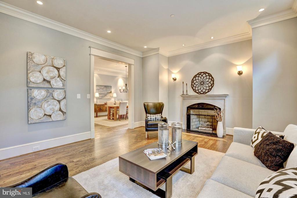 Living room features handsome fireplace. - 116 E MELROSE ST, CHEVY CHASE